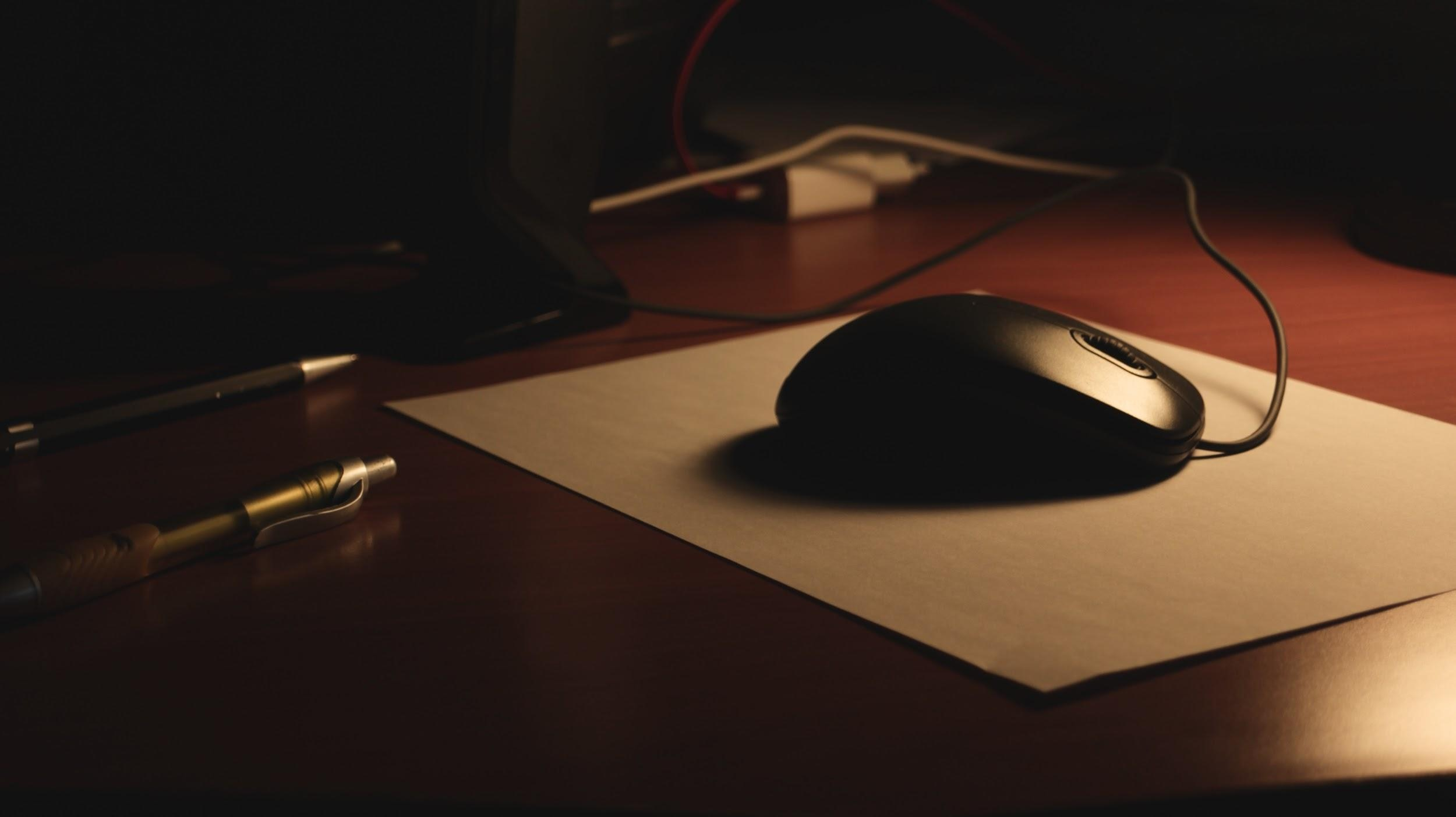 pens and mouse on a desk